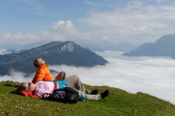 Austria, Tyrol, Chiemgau Alps, Hikers resting at Fellhorn mountain