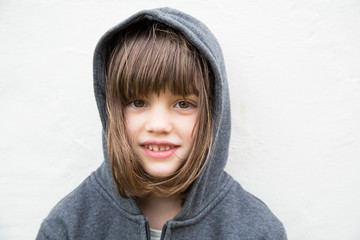 Portrait of smiling little girl with hoodie jacket