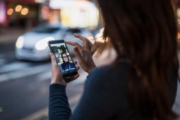 Woman taking a selfie by the roadside