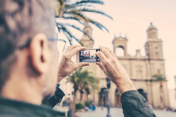 Spain, Canary Islands, Gran Canaria, Las Palmas, man taking picture of Catedral de Santa Ana
