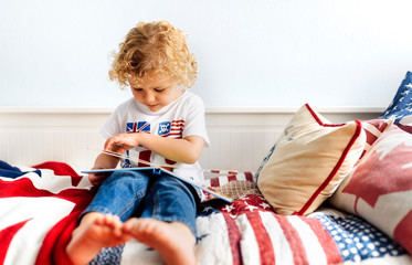 Little boy watching picture book