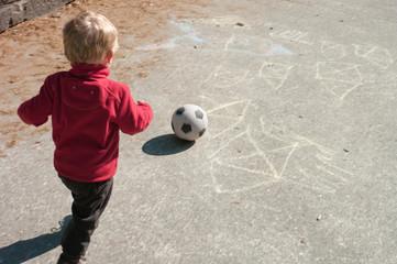 Baby boy playing soccer