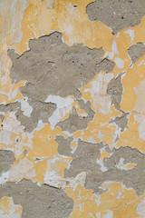 a peeling plaster on a wall