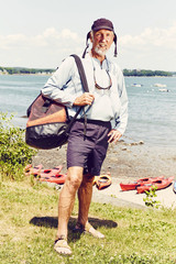 Portrait of mature man about to embarks on a kayak trip in Casco Bay