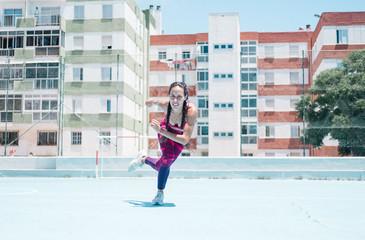 Colorful image of female athlete exercising on court