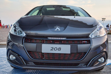 A front view of a new Pegeout 208 car from Pegeout automaker in outdoor showroom, Rome,Italy - July 21, 2018
