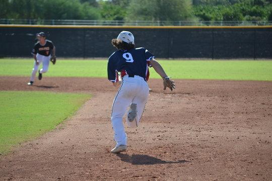 Baseball Player stealing second base