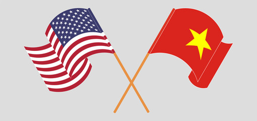 Crossed and waving flags of Vietnam and the USA
