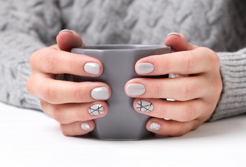 Aluminium Prints Manicure Woman's hands with geometric manicure nail design in cozy sweater