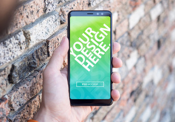 Person Holding Full Screen Smartphone Mockup