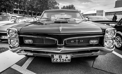 Muscle car Pontiac GTO, (first generation) on May 01, 2019 in Berlin, Germany. Black and white.