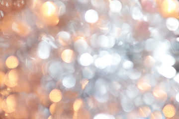 Golden christmas background and new year concept, abstract defocused light background with bokeh and blur. Winter banner for your text, background image or overlay layer in the photo editor,
