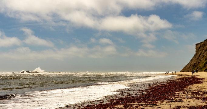 People enjoying the outdoors at Mavericks Beach, Half Moon Bay, Highway 1, Northern California.