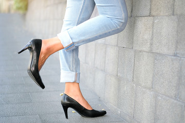Women wear jeans modern fashion And black high heels She standing road in old town Wall mural