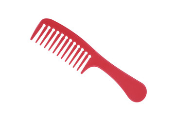 Red plastic comb isolated on white with clipping path