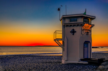 Sunset in Laguna Beach, famous tourist destination in California, USA with a lifeguard station in the foreground