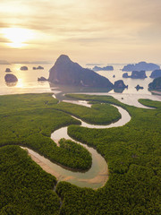 Wall Murals Beige Aerial top view of Samet Nangshe, mountain valley hills, and tropical green forest trees at sunset with Andaman sea in Phang Nga Bay in summer, Thailand in travel trip. Natural landscape background.