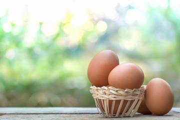 brown eggs in basket on bokeh background