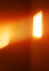 Dramatic light ray through the window of prison cell background