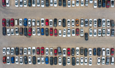 Aerial shot many vehicles parked parking lot top view