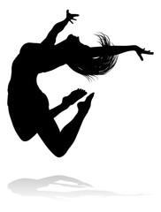 A silhouette woman dancing in mid air jumping