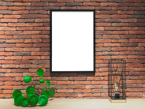 Blank framed poster on the brick wall, mock up