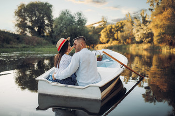 Happy love couple boating on lake, romantic date