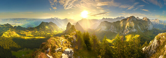 Spoed Fotobehang Ochtendgloren Autumn mountains at sunrise in Switzerland