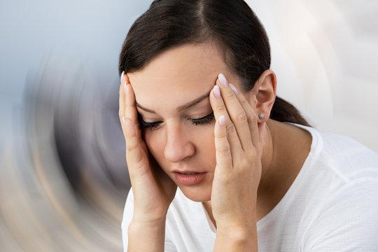 Woman Suffering From Headache Dizziness