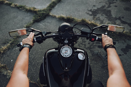 Close up of biker holding a motorcycle wheel