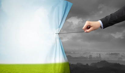 Fotomurales - hand pulling green landscape curtain to gray landscape, environmental protection concept