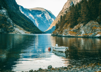 boat on the shore of the fjord in Norway, beautiful Scandinavian landscape, travel to Norway