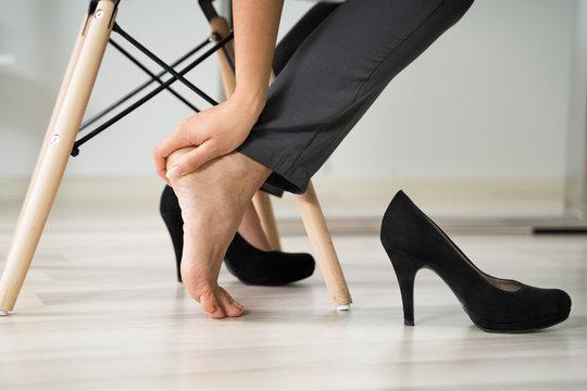 Businesswoman Rubbing Her Feet