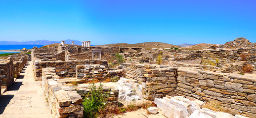 general view of ancients houses in the archaeological city of Delos Island, near Mykonos, beautiful Cycladic island, in the heart of the Aegean Sea