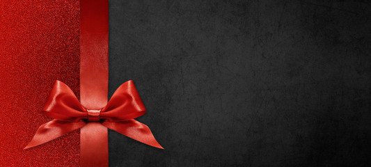 gift card wishes merry christmas background with red ribbon bow on black shiny vibrant color...