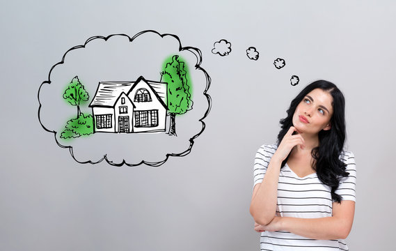Dreaming of new home with young woman in a thoughtful face