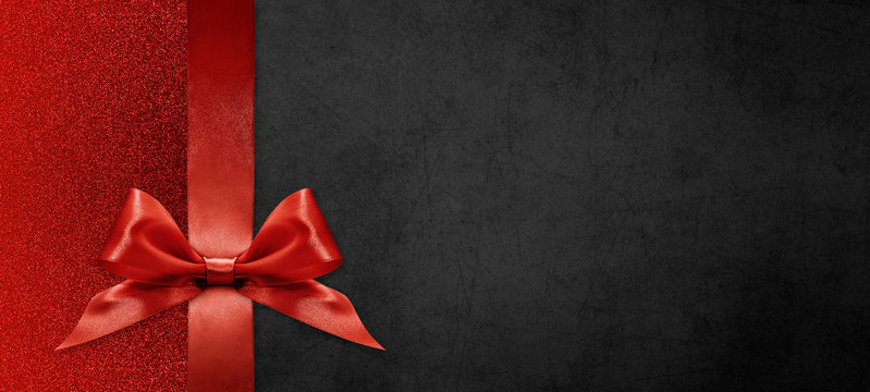 gift card wishes merry christmas background with red ribbon bow on black shiny vibrant color texture template with blank copy space
