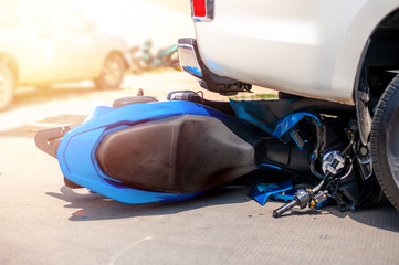 Motorcycle and car accident on a highway,