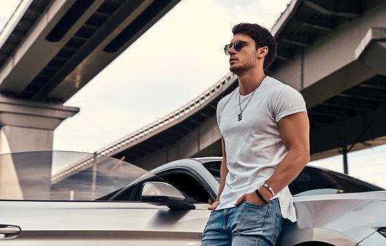 Handsome man near car