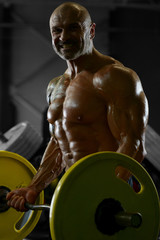 Printed kitchen splashbacks Buddha Handsome strong athletic men pumping up biceps muscles workout fitness and bodybuilding concept background - muscular bodybuilder fitness men doing arms exercises in gym naked torso.