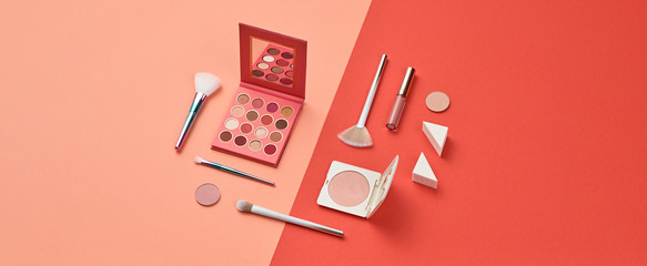Cosmetic makeup accessories layout. Fashion creative minimal Set. Trendy Design Clutch, lipstick brushes. Art Concept colorful pastel Style. Beauty cosmetic make up tools, fashionable flat lay