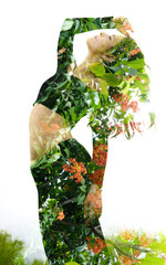 Double exposure of an elegant girl leaning back combined with photograph of bright tropical plants with vibrant flowers