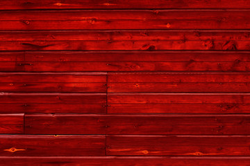 Stained natural wood plank texture. Dark red wooden background