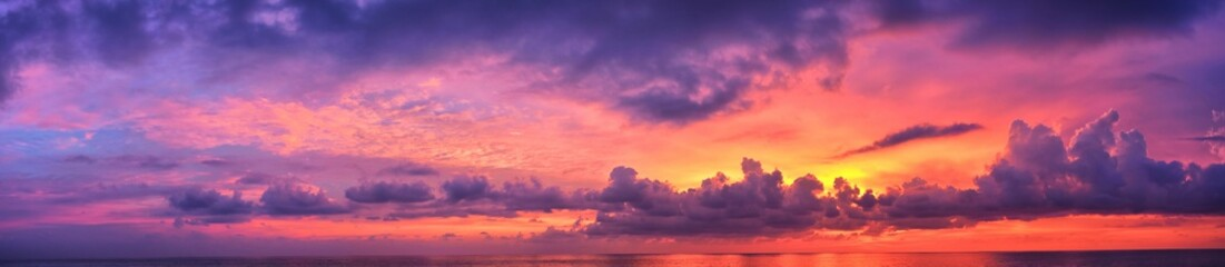 Fotobehang Snoeien Phuket beach sunset, colorful cloudy twilight sky reflecting on the sand gazing at the Indian Ocean, Thailand, Asia.