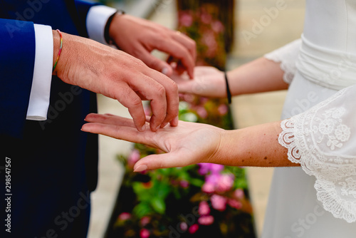 Newly-married couple stroking the palms of their hands