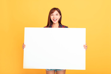 Young Asian woman holding blank billboard  for advertising signs