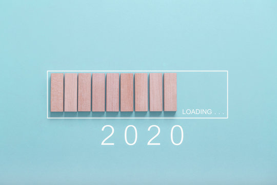 Loading new year 2020 concept , Showing loading bar with wood cube on bluebackground