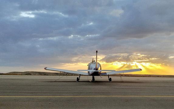 SDE TEYMAN, ISRAEL -  DECEMBER 5, 2018: Piper PA-28-180 Cherokee D plane parked. Sunset time