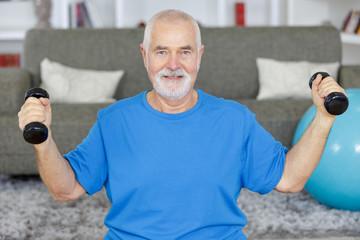 senior man doing exercise at home