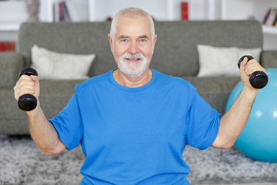 senior man doing exercise at home